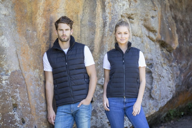 Models wear Beacon Loma Unisex Puffer Vest in Black